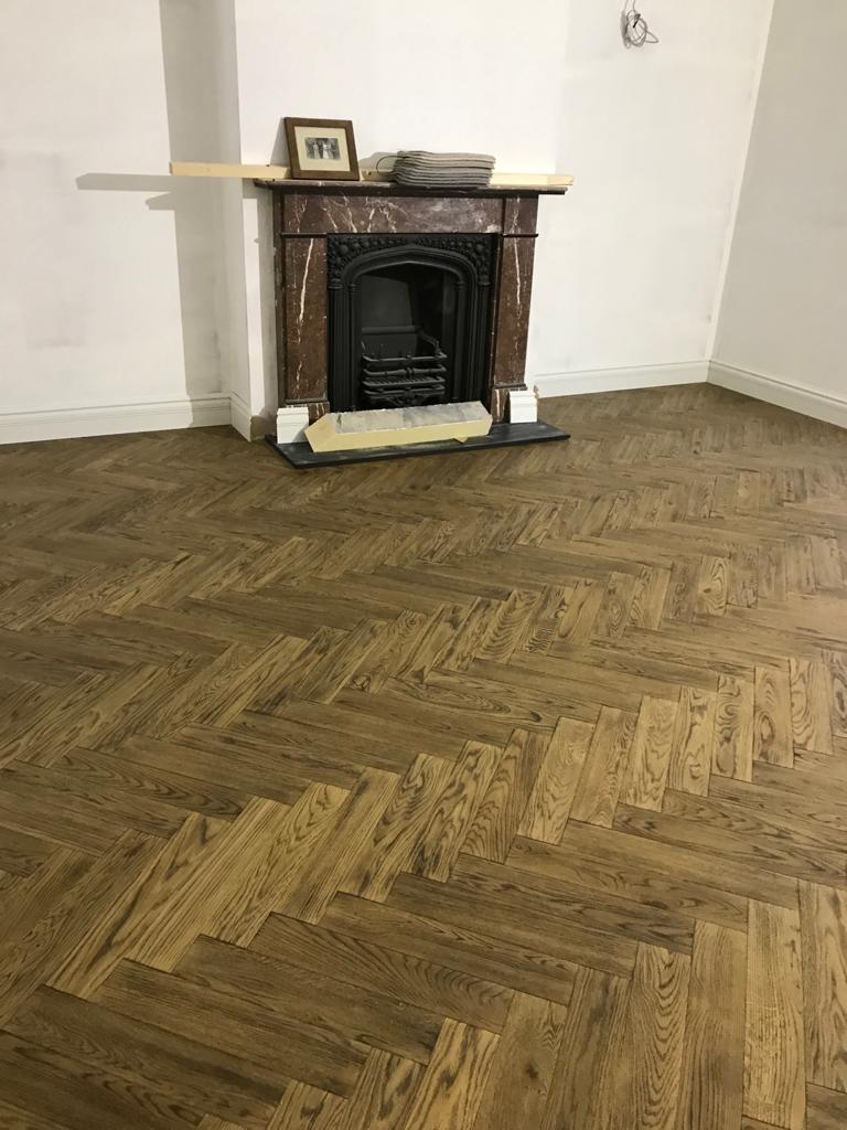 Installation of parquet. Bespoke produced by Priory Hardwoods Ltd