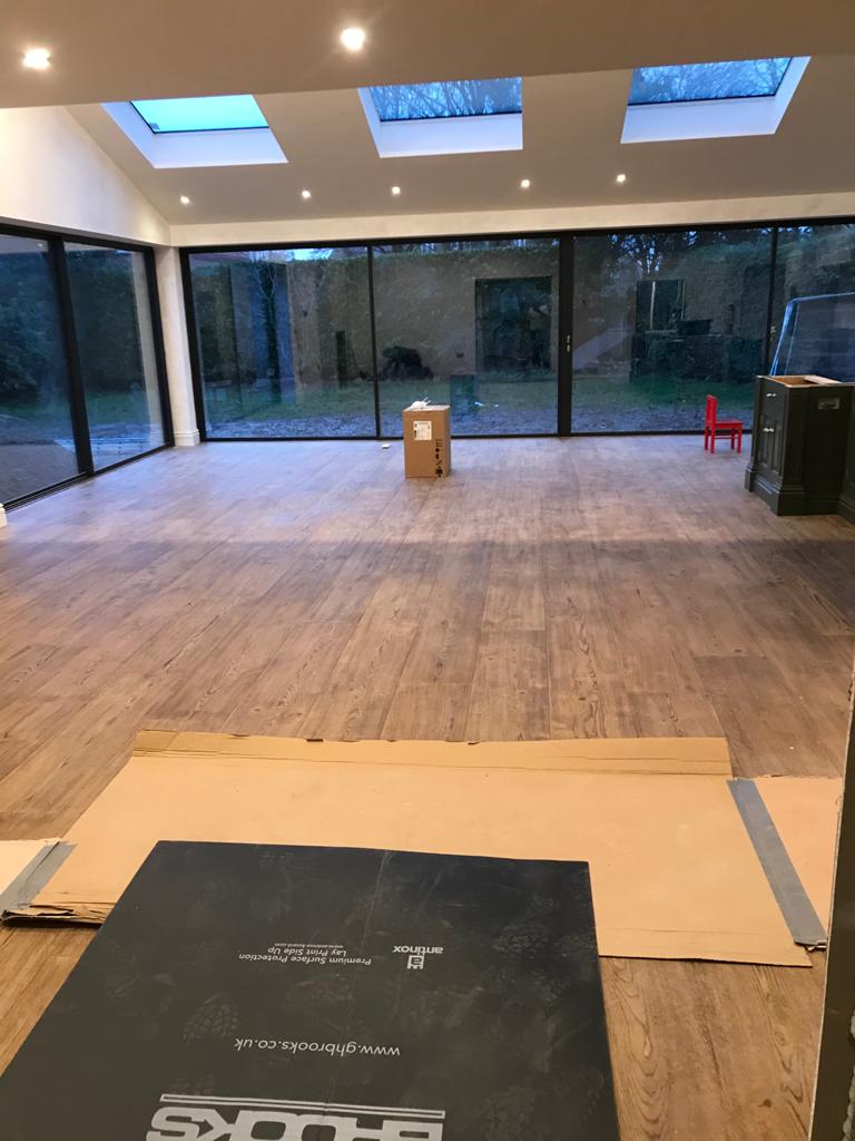 Installation of wide planks. Bespoke produced by Priory Hardwoods Ltd
