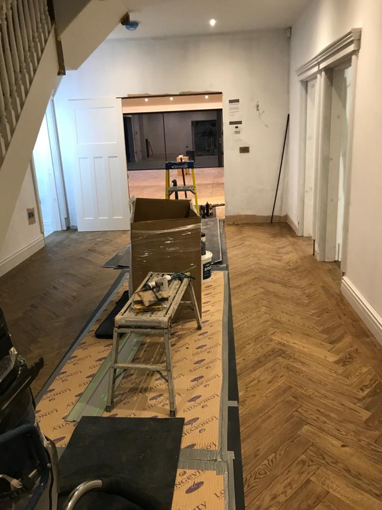 Installation of parquet with strip boarder. Bespoke produced by Priory Hardwoods Ltd