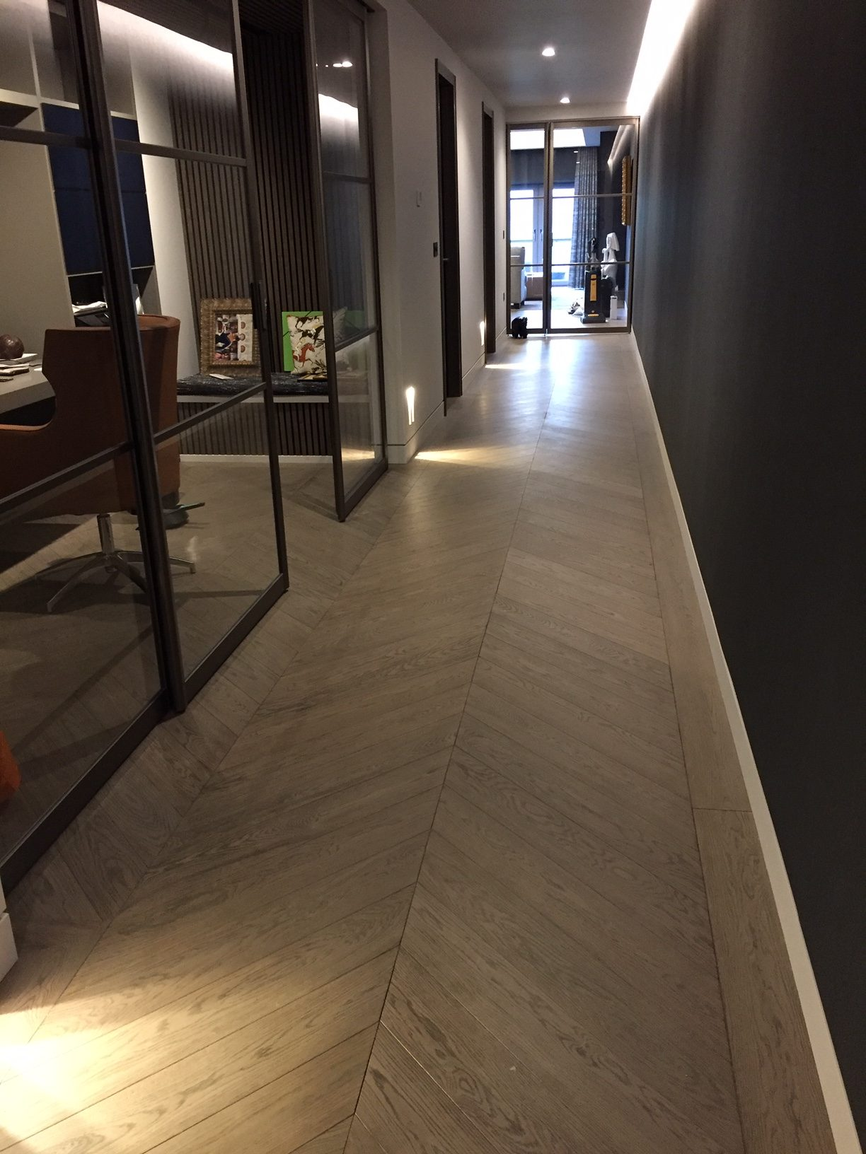 Installation of engineered oak chevron floor. Bespoke produced by Priory Hardwoods Ltd